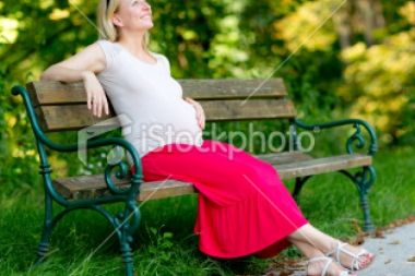 stock-photo-22308083-pregnant-woman-relaxing-park-bench